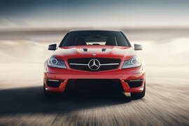 Saratov Russia - August 24 2014: Red Sport Car Mercedes-Benz C63 AMG Drive Speed On Asphalt Road At Sunset