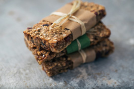 Group of delicious granola bars on metal surface